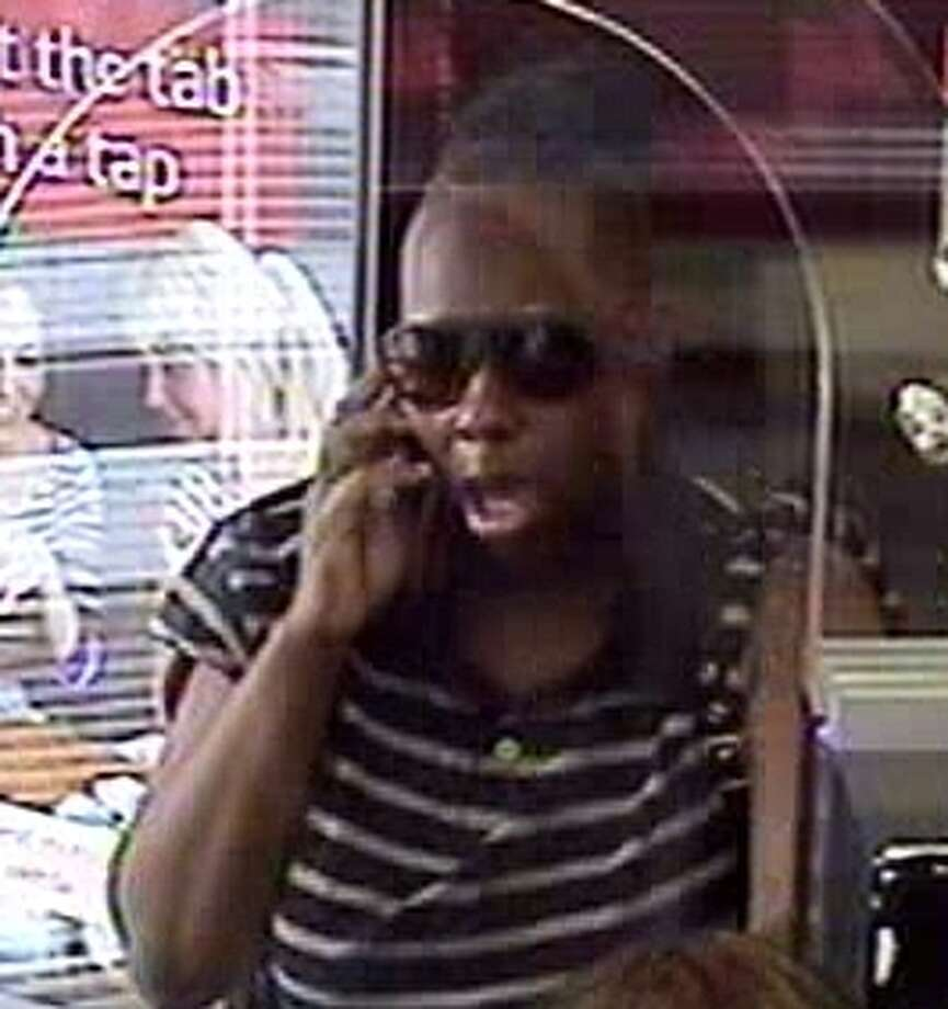 Police are looking for this woman, who is accused of trying to rob two Houston banks within an hour.  Each time, she left in a cab. (FBI surveillance video)