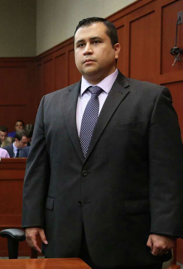 SANFORD, FL - JULY 13:  George Zimmerman listens as the verdict is announced that the jury finds him not guilty, on the 25th day of his trial at the Seminole County Criminal Justice Center July 13, 2013 in Sanford, Florida. Zimmerman was charged with second-degree murder in the 2012 shooting death of Trayvon Martin.  (Photo by Joe Burbank-Pool/Getty Images) ORG XMIT: 173521643 Photo: Pool / 2013 Getty Images