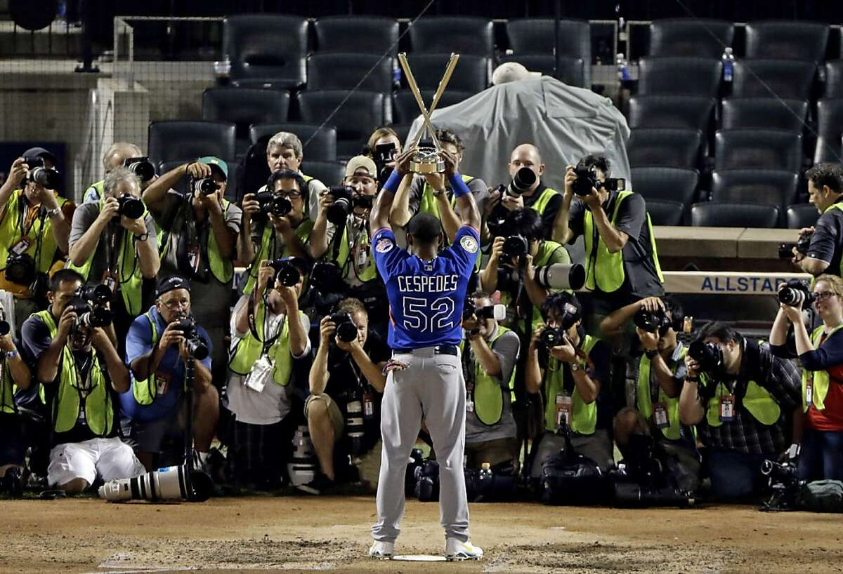 American League's Yoenis Cespedes of the Oakland Athletics holds up his trophy after winning the MLB All-Star baseball Home Run Derby, Monday, July 15, 2013, in New York. (AP Photo/Frank Franklin II)