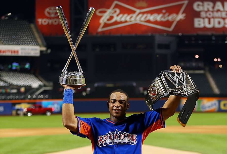 Yoenis Cespedes of the Oakland Athletics poses with the trophy after winning Chevrolet Home Run Derby. Photo: Mike Ehrmann, Getty Images