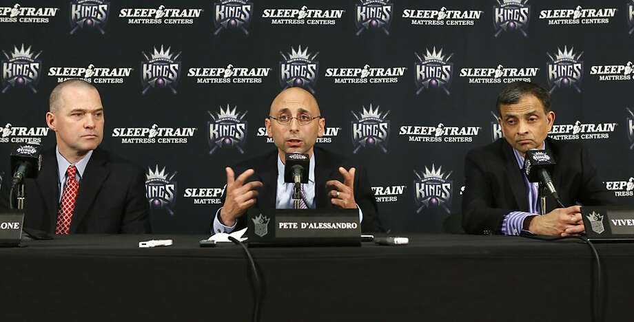 Pete D'Alessandro, center, discusses his hiring as the new general manager of the Sacramento Kings basketball team, by the teams new owner, Vivek Ranadive, right, at a news conference in Sacramento, Calif., Monday June 17, 2013.  D'Alessandro, who spent the past three seasons with the Denver Nuggets,  replaces Geoff Petrie, who had been notified that he would not retained after his contract expired June 30.  At left is Kings head coach Michael Malone.(AP Photo/Rich Pedroncelli) Photo: Rich Pedroncelli, Associated Press