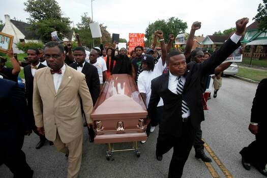 "Protesters carried a coffin during the rally. ""This is where they wish to send young black men - to the funeral home,"" Quanell X said. Photo: Eric Kayne, For The Chronicle / ©2013 Eric Kayne"