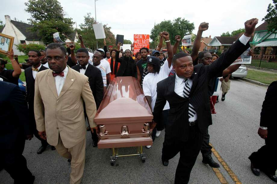 Protesters stop traffic on Texas 288 Monday, above, as activist Quanell X, at right, and local community leaders and hip-hop stars lead a protest that began at the Byrd Funeral Home on Wheeler. Photo: Eric Kayne, For The Chronicle / ©2013 Eric Kayne
