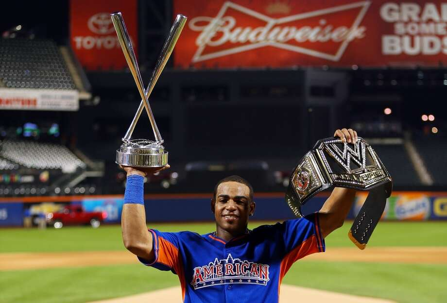 Yoenis Cespedes of the Oakland Athletics poses with the trophy after winning Chevrolet Home Run Derby on July 15, 2013 at Citi Field.