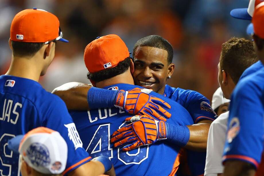 Yoenis Cespedes of the A's is congratulated after winning the Home Run Derby.