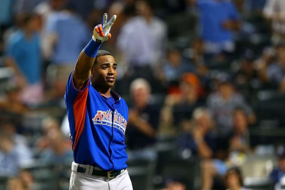 Yoenis Cespedes of the A's waves to the crowd after winning the Home Run Derby.