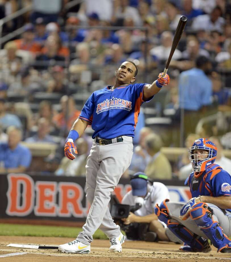 Yoenis Cespedes of the A's takes as wing during the Home Run Derby.