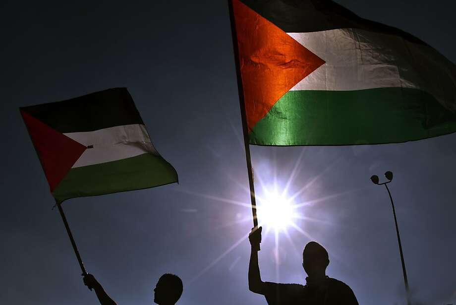 Protesters wave Palestinian flags during a demonstration against Israeli government's plans to relocate Bedouins in the Negev desert in the Arab Israeli city of Umm al-Fahm on July 15, 2013.   TOPSHOTS/AFP PHOTO / JACK GUEZJACK GUEZ/AFP/Getty Images Photo: Jack Guez, AFP/Getty Images
