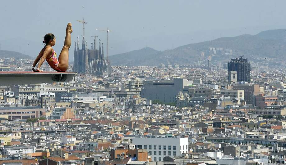 The Sagrada Familia cathedral is seen in the background as a diver practices ahead of the FINA World Championships in Barcelona, Spain. Photo: Manu Fernandez, Associated Press