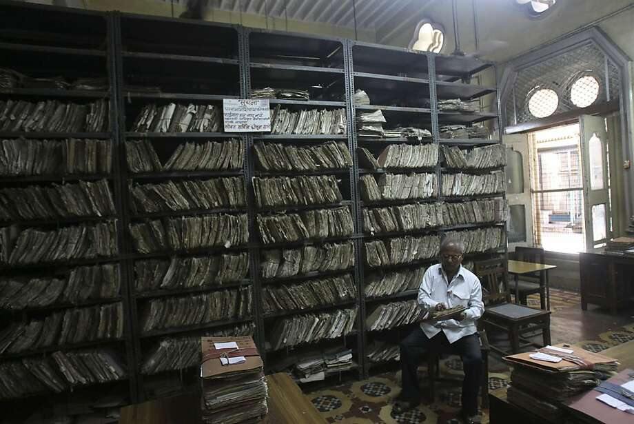 An employee checks a file inside the records room of the Central Telegraph Office in Mumbai, India, Monday, July 15, 2013. India's last telegram went out late Sunday, marking the end of a service that millions of Indians had relied on for fast communication for more than 160 years. (AP Photo/Rafiq Maqbool) Photo: Rafiq Maqbool, Associated Press