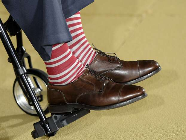 Bush, in a pair of red and white socks, participates in the 5,000th Daily Point of Light Award ceremony July 15, 2013, at the White House. Photo: Susan Walsh, Associated Press