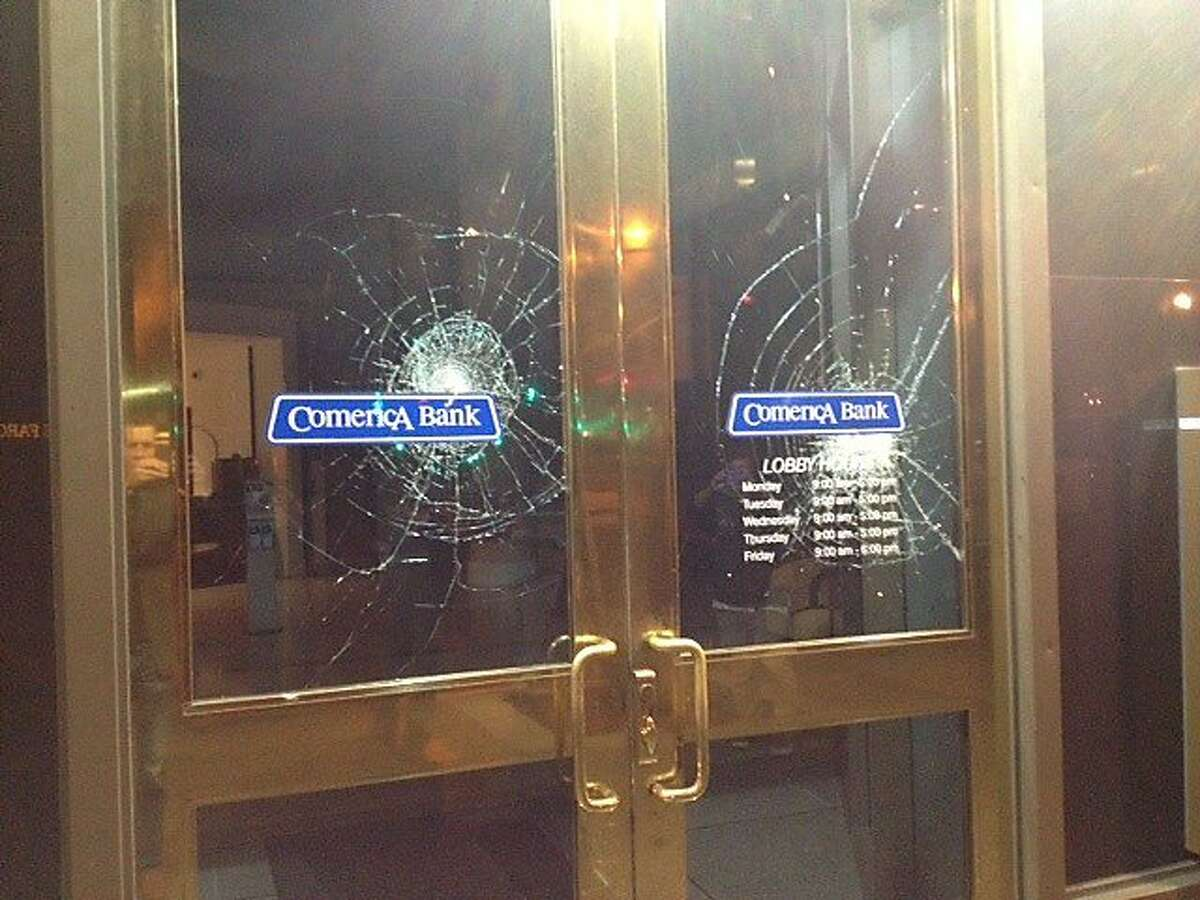 Smashed windows are seen at Comerica Bank on July 15, 2013 in Oakland, Calif.