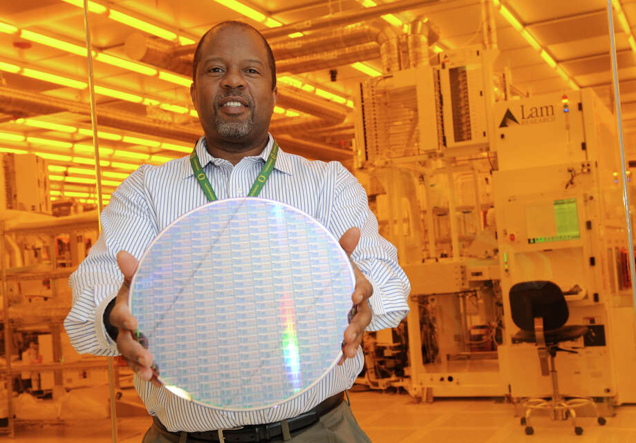 Warren Montgomery, asstistant V.P. in advanced technology business development, holds a silicon wafer in front of a clean room at the College for Nanoscale Science on Thursday Dec. 20, 2012 in Albany, N.Y.  (Lori Van Buren / Times Union) Photo: Lori Van Buren / 00020451A