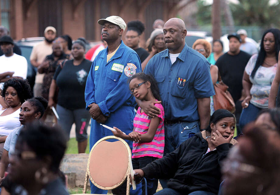 Philip Cole holds Pharrah Cole during a Trayvon Martin rally in Port Arthur on Monday. About 100 people attended the event where candles were later lit to honor Martin. Judge Thompkins stands by them. Photo taken Monday, July 15, 2015 Guiseppe Barranco/The Enterprise Photo: Guiseppe Barranco, STAFF PHOTOGRAPHER / The Beaumont Enterprise