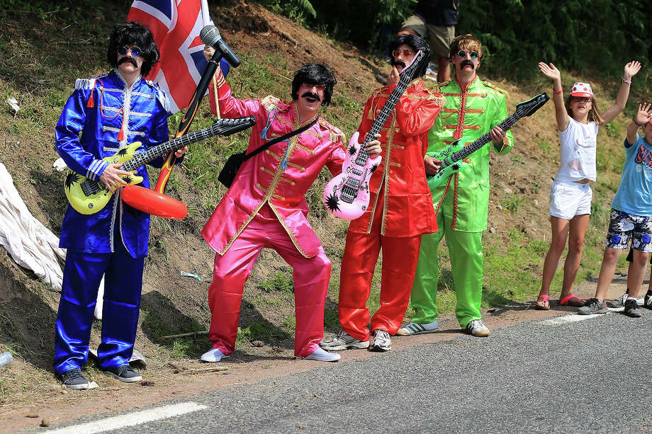 Fans dressed as The Beatles enjoy the atmosphere during stage fourteen of the 2013 Tour de France, a 191KM road stage from Saint-Pourcain-sur-Sioule to Lyon, on July 13, 2013 in Lyon, France. Photo: Doug Pensinger, Getty Images / 2013 Getty Images