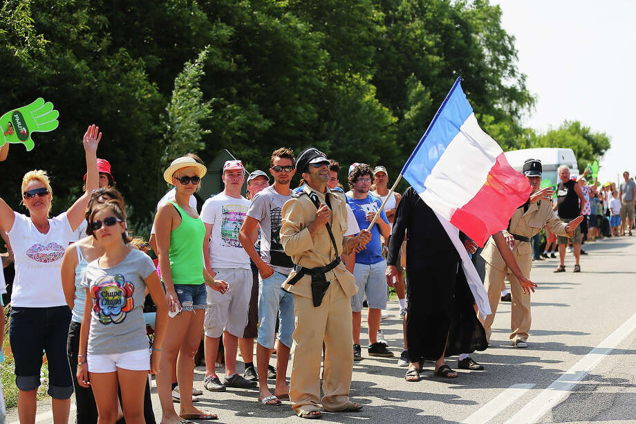 French fans are seen on Bastille Day during stage fifteen of the 2013 Tour de France, a 242.5KM road stage from Givors to Mont Ventoux, on July 14, 2013 in Givors, France. Photo: Bryn Lennon, Getty Images / 2013 Getty Images