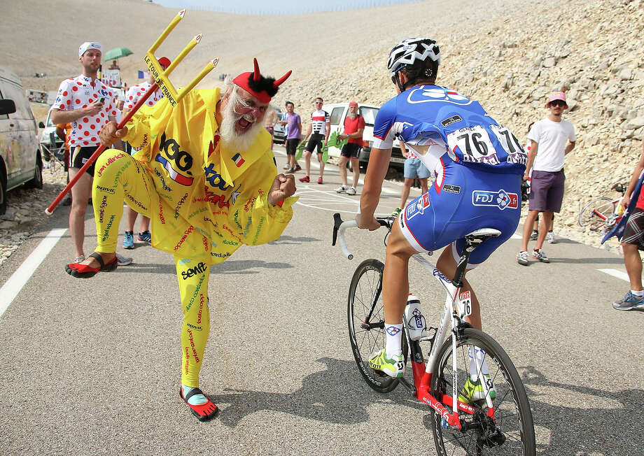 El Diablo supports Alexandre Geniez of France and Team FDJ.fr during stage fifteen of the 2013 Tour de France, a 242.5KM road stage from Givors to Mont Ventoux, on July 14, 2013 in Mont Ventoux, France. Photo: John Berry, Getty Images / 2013 John Berry