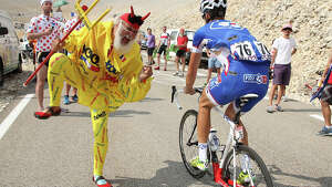 El Diablo supports Alexandre Geniez of France and Team FDJ.fr during stage fifteen of the 2013 Tour de France, a 242.5KM road stage from Givors to Mont Ventoux, on July 14, 2013 in Mont Ventoux, France.