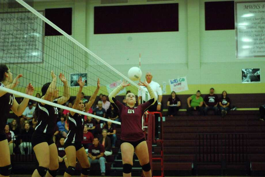 Junior setter Jennifer Stanaland serves up a ball against Waller last season.