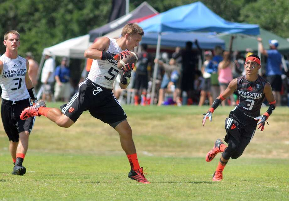 The Woodlands receiver Bayley Novak, center, makes a catch in front of an Edcouch-Elsa defender during their pool game at the 2013 Division I 7-on-7 State Championhip at Southwest County Regional Park in Leander on Thursday. Freelance photo by Jerry Baker Photo: Jerry Baker, Freelance