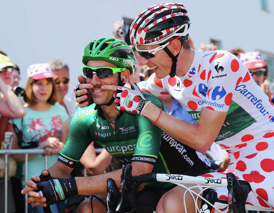 Polka dot jersey wearer Pierre Rolland (R) of France and Team Europcar jokes with team mate JÈrome Cousin (L) of France before stage ten of the 2013 Tour de France, a 197KM road stage from St-Gildas-des-Bois to Saint Malo, on July 9, 2013 in St-Gildas-des-Bois, France. Photo: Bryn Lennon, Getty Images / 2013 Getty Images