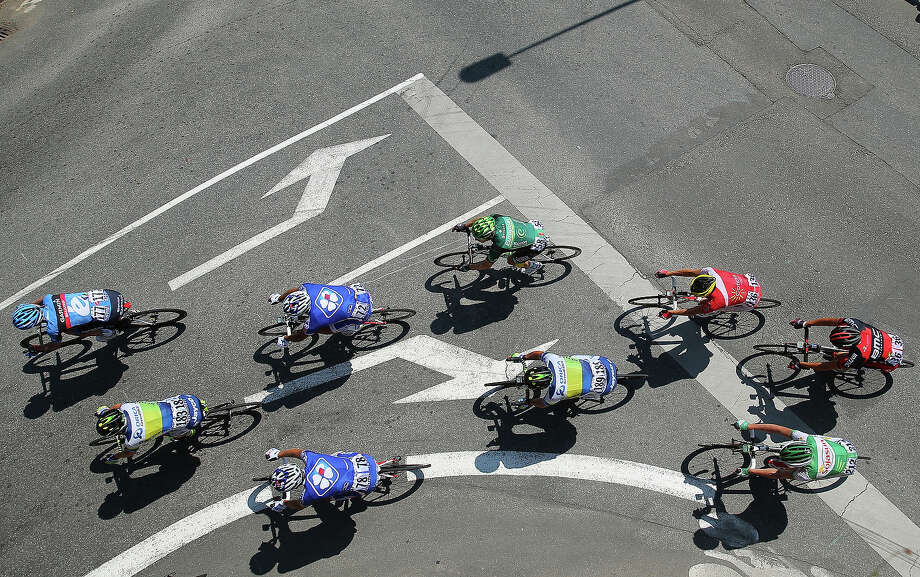 The peloton ride on stage ten of the 2013 Tour de France, a 197KM road stage from St-Gildas-des-Bois to Saint Malo, on July 9, 2013 in St Malo, France. Photo: Bryn Lennon, Getty Images / 2013 Getty Images