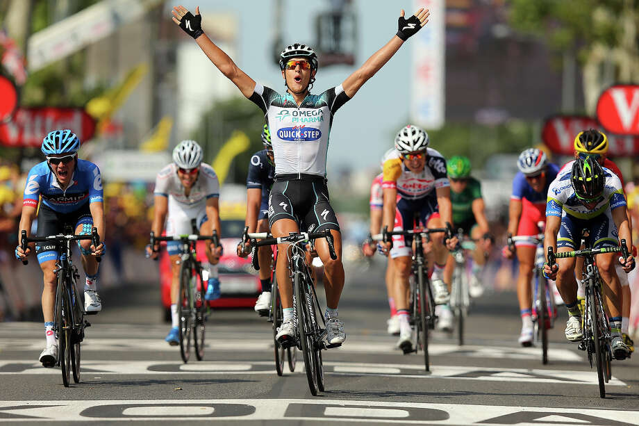 Matteo Trentin of Italy and Omega Pharma-Quickstep celebrates winning stage fourteen of the 2013 Tour de France, a 191KM road stage from Saint-Pourcain-sur-Sioule to Lyon, on July 13, 2013 in Lyon, France. Photo: Bryn Lennon, Getty Images / 2013 Getty Images
