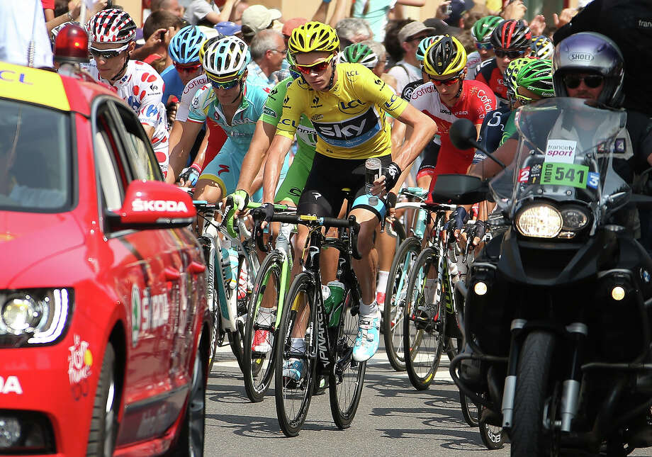 Race Leader Christopher Froome of Great Britain and Team Sky Procycling in action during Stage Fourteen of the 2013 Tour de France, a 191 km road stage from Saint-Pourcain-sur-Sioule to Lyon on July 13, 2013 in Saint-Pourcain-sur-Sioule, France. Photo: John Berry, Getty Images / 2013 John Berry