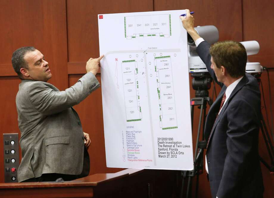 FILE - Defense attorney Mark O'Mara, right, questions Sanford, Fla., police officer Chris Serino during the George Zimmerman trial in Seminole circuit court, in this July 2, 2013 file photo in Sanford. The woman known as Juror B37 told CNN's Anderson Cooper Monday July 15, 2013 that Zimmerman made some poor decisions leading up to the shooting, but that Martin wasn't innocent either. The juror said Sanford Police Detective Chris Serino made a big impression on her, because he would have been accustomed to dealing with murders and similar cases. He would have known how to spot a liar, and yet he testified that he believed Zimmerman, the juror said. Photo: Orlando Sentinel, Joe Burbank
