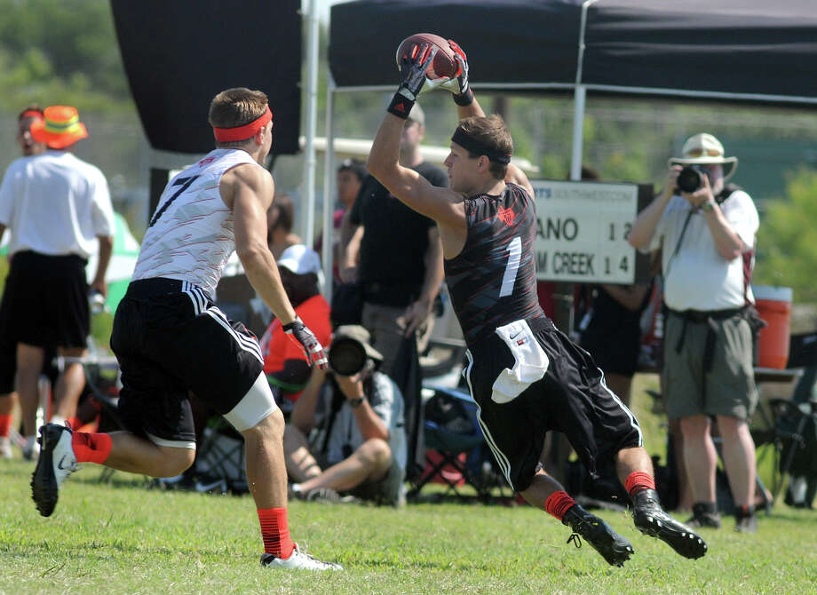 Langham Creek senior receiver Bryce Langan (#1) makes a recption against a Plano defender during their elimination game at the 2013 Division 7-on-7 State Championship at Southwest County Regional Park in Leander on Saturday. Photo: Jerry Baker, Freelance