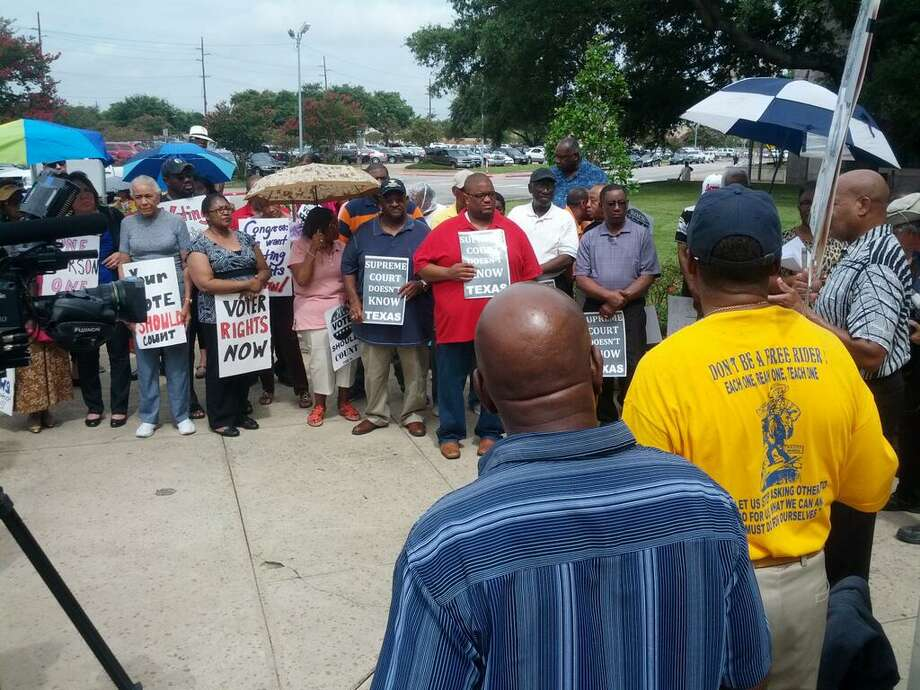 A group of Beaumont residents protests the recent Supreme Court rulling of the Voting Rights Act outside the Jefferson County Courthouse on Tuesday, July 16, 2013.  Guiseppe Barranco/The Beaumont Enterprise