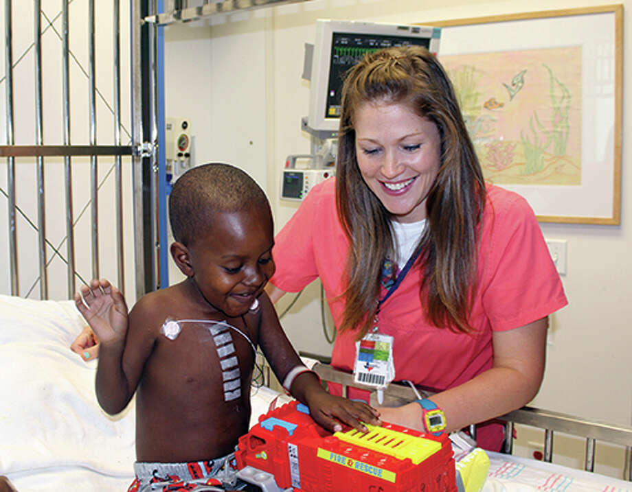 Three-year-old Angel Rodriguez of the Domican Republic is shown with nurse Kate Graham at Children's Memorial Hermann Hospital. Photo: Children's Memorial Hermann Hospital