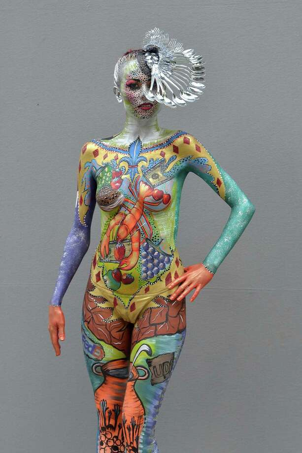A participant poses with her body paintings designed by bodypainting artist Einat Dan during the 16th World Bodypainting Festival on July 5, 2013 in Poertschach am Woerthersee, Austria. Photo: Didier Messens, Getty Images / 2013 Didier Messens