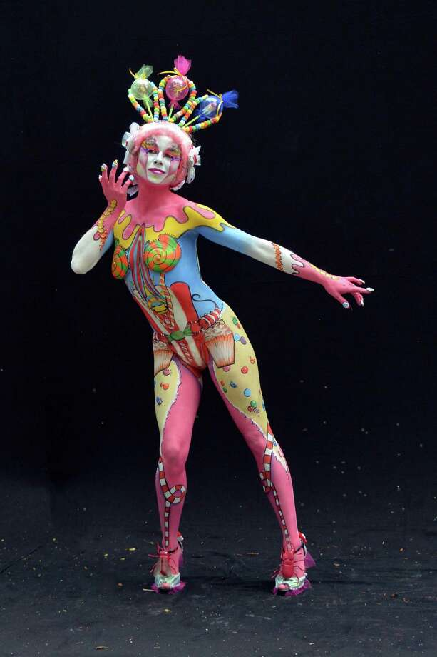 A participant poses with her body paintings designed by bodypainting artist Johanna Soegeng during the 16th World Bodypainting Festival on July 5, 2013 in Poertschach am Woerthersee, Austria. Photo: Didier Messens, Getty Images / 2013 Didier Messens