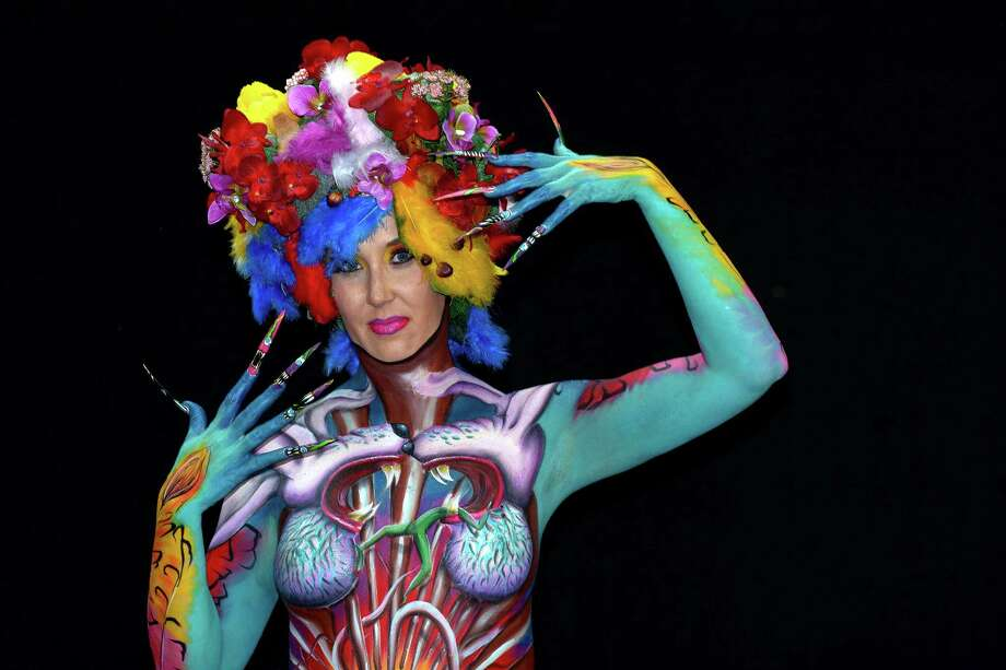 A participant poses with her body paintings designed by bodypainting artist Tera Bakker during the 16th World Bodypainting Festival on July 5, 2013 in Poertschach am Woerthersee, Austria. Photo: Didier Messens, Getty Images / 2013 Didier Messens