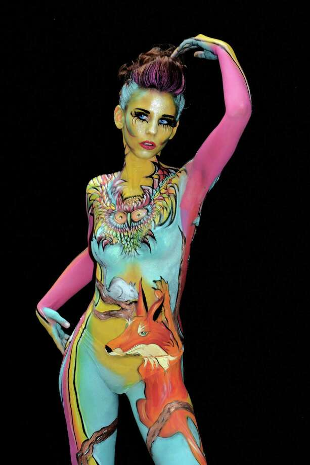A participant poses with her body paintings designed by bodypainting artist Nicole Aspradaki during the 16th World Bodypainting Festival on July 5, 2013 in Poertschach am Woerthersee, Austria. Photo: Didier Messens, Getty Images / 2013 Didier Messens