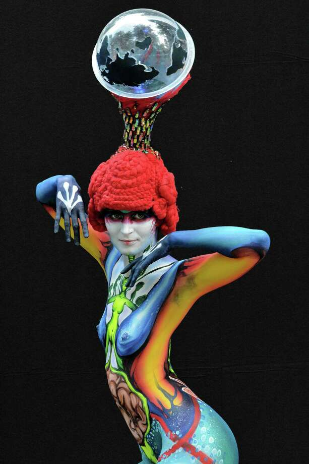 A participant poses with her body paintings designed by bodypainting artist Min Ah KIM during the 16th World Bodypainting Festival on July 5, 2013 in Poertschach am Woerthersee, Austria. Photo: Didier Messens, Getty Images / 2013 Didier Messens
