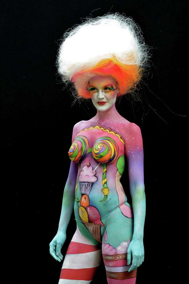 A participant poses with her body paintings designed by bodypainting artist Birgit Rhomberg during the 16th World Bodypainting Festival enter caption here on July 5, 2013 in Poertschach am Woerthersee, Austria. Photo: Didier Messens, Getty Images / 2013 Didier Messens