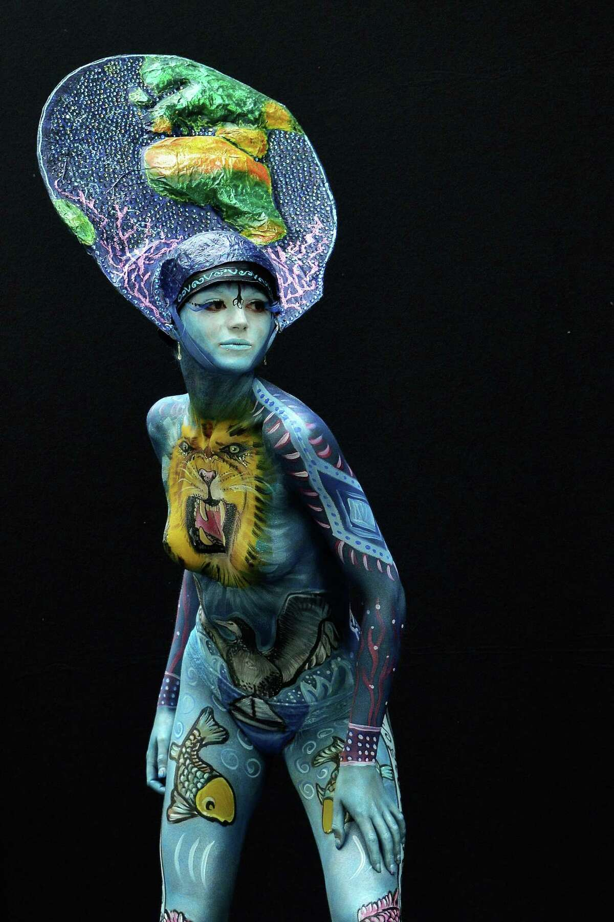 A participant poses with her body paintings designed by bodypainting artist Magali Couset during the 16th World Bodypainting Festival on July 5, 2013 in Poertschach am Woerthersee, Austria.