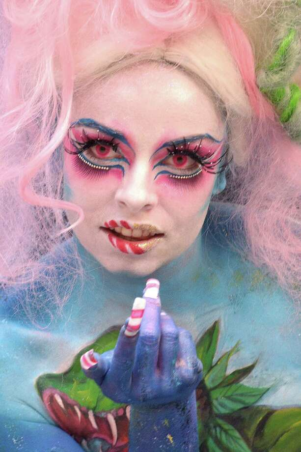 A participant poses with her body paintings designed by bodypainting artist Sophia Benomar during the 16th World Bodypainting Festival on July 5, 2013 in Poertschach am Woerthersee, Austria. Photo: Didier Messens, Getty Images / 2013 Didier Messens