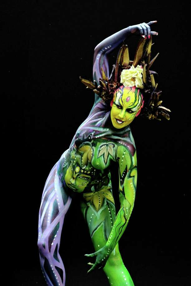 A participant poses with her body paintings designed by bodypainting artist Bert Verstappen during the 16th World Bodypainting Festival on July 5, 2013 in Poertschach am Woerthersee, Austria. Photo: Didier Messens, Getty Images / 2013 Didier Messens