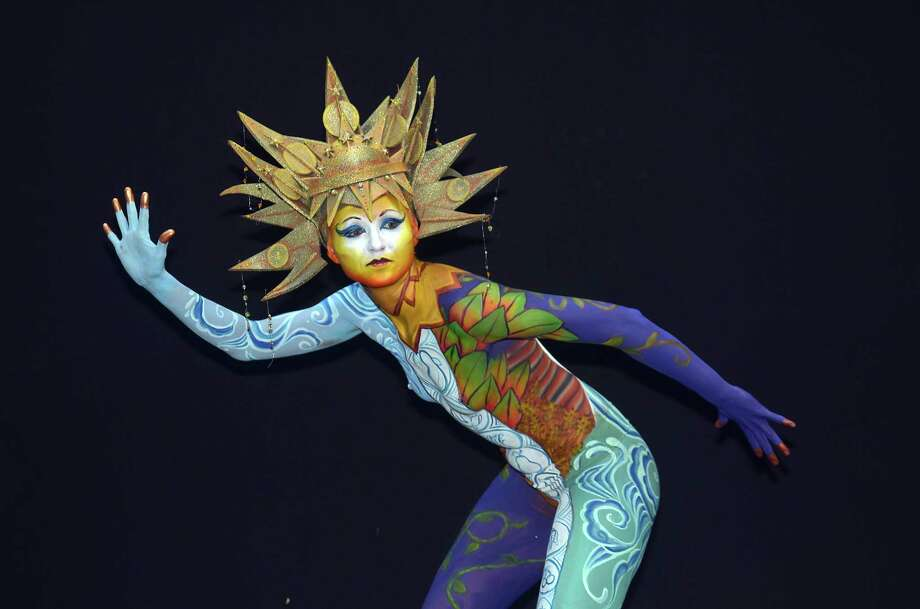 A participant poses with her body paintings designed by bodypainting artist Deborah Brommer during the 16th World Bodypainting Festival on July 5, 2013 in Poertschach am Woerthersee, Austria. Photo: Didier Messens, Getty Images / 2013 Didier Messens