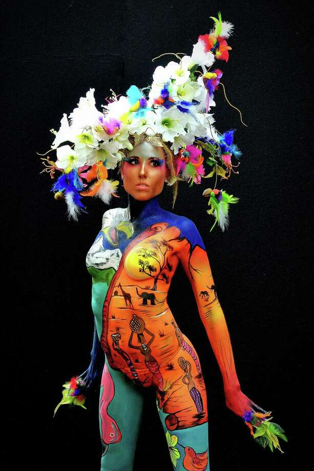 A participant poses with her body paintings designed by bodypainting artist Sonja Wiesendanger during the 16th World Bodypainting Festival on July 5, 2013 in Poertschach am Woerthersee, Austria. Photo: Didier Messens, Getty Images / 2013 Didier Messens