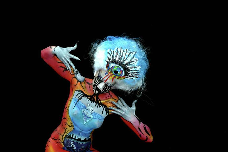 A participant poses with her body paintings designed by bodypainting artist Sarah Ashleigh during the 16th World Bodypainting Festival on July 5, 2013 in Poertschach am Woerthersee, Austria. Photo: Didier Messens, Getty Images / 2013 Didier Messens