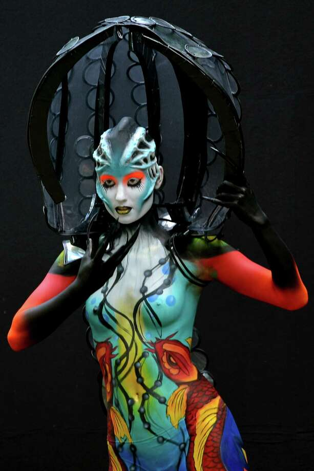 A participant poses with her body paintings designed by bodypainting artist Edina Vadocz during the 16th World Bodypainting Festival on July 5, 2013 in Poertschach am Woerthersee, Austria. Photo: Didier Messens, Getty Images / 2013 Didier Messens