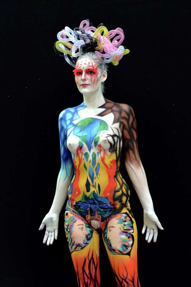 A participant poses with her body paintings designed by bodypainting artist Kang Hye Won during the 16th World Bodypainting Festival on July 5, 2013 in Poertschach am Woerthersee, Austria. Photo: Didier Messens, Getty Images / 2013 Didier Messens
