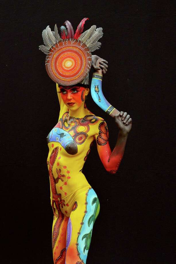 A participant poses with her body paintings designed by bodypainting artist Arianna Barlini during the 16th World Bodypainting Festival on July 5, 2013 in Poertschach am Woerthersee, Austria. Photo: Didier Messens, Getty Images / 2013 Didier Messens