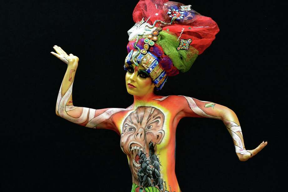 A participant poses with her body paintings during the 16th World Bodypainting Festival on July 5, 2013 in Poertschach am Woerthersee, Austria. Photo: Didier Messens, Getty Images / 2013 Didier Messens
