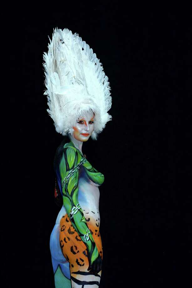 A participant poses with her body paintings designed by bodypainting artist Ilaria Avesani during the 16th World Bodypainting Festival on July 5, 2013 in Poertschach am Woerthersee, Austria. Photo: Didier Messens, Getty Images / 2013 Didier Messens