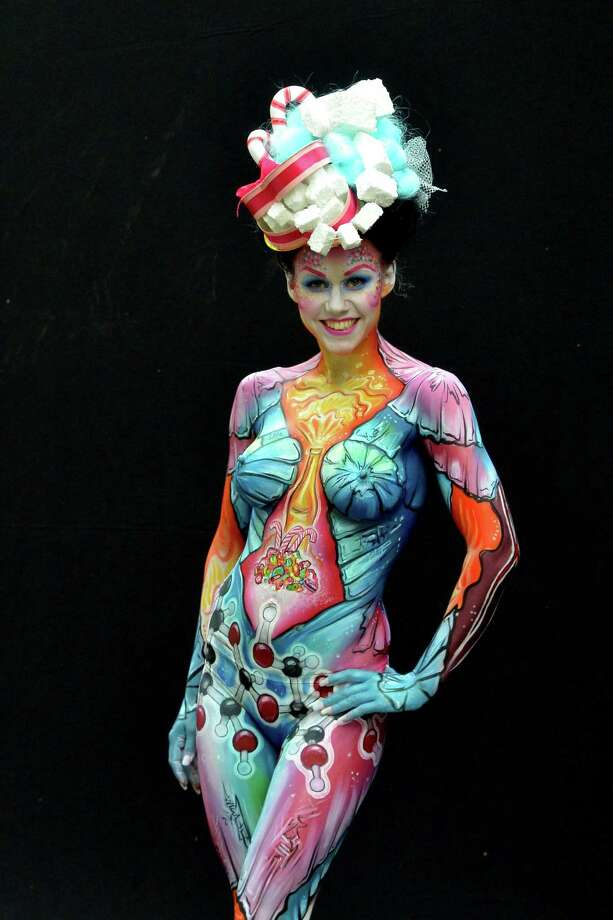 A participant poses with her body paintings designed by bodypainting artist Riina Laine during the 16th World Bodypainting Festival on July 5, 2013 in Poertschach am Woerthersee, Austria. Photo: Didier Messens, Getty Images / 2013 Didier Messens